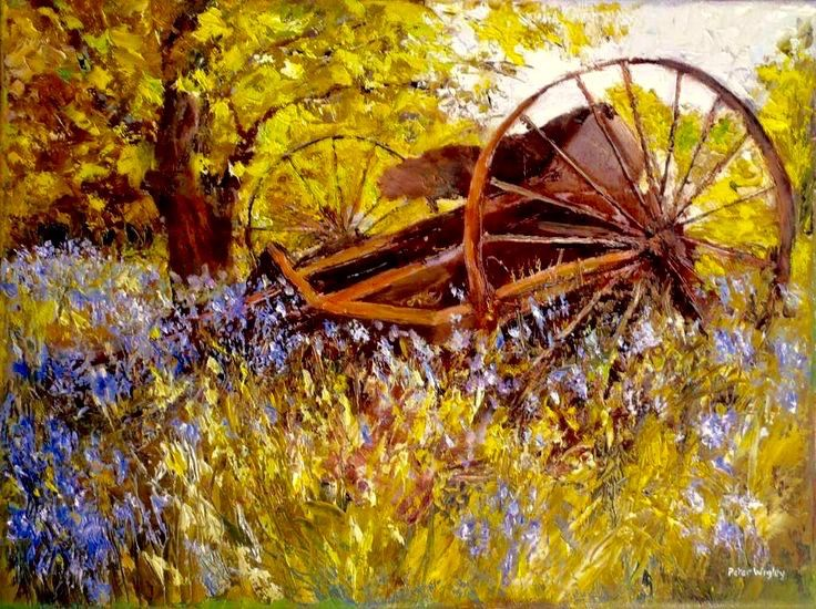 rusting farm implement in bluebell field